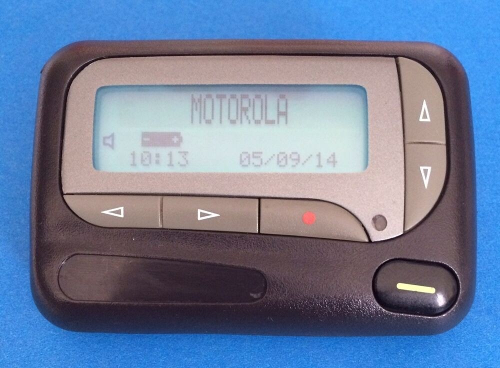 Motorola pager showing the name brand, date as 05/09/14 and time as 10:13. Battery full, volume on